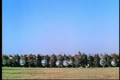 Wide shot medieval soldiers on the attack Stock Footage