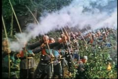 Medieval soldiers shooting fire out of arrows - stock footage