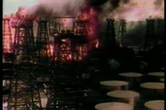 Black smoke spreading through burning oil refinery - stock footage