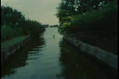 Point of view  from motorboat speeding down canal Stock Footage