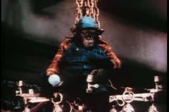 Monkey sitting on chandelier sticking finger in socket Stock Footage