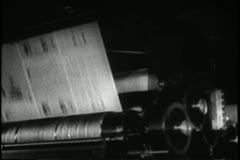 Close-up printing press printing newspapers - stock footage