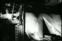 Stock Video Footage of Printing press printing newspapers