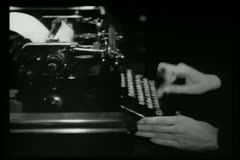 Zoom in fingers tapping out morse code message on typewriter Stock Footage