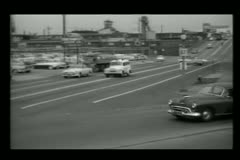 1950s paddy wagon arriving at bank Stock Footage