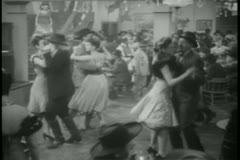 Wide shot couples dancing in bar Stock Footage