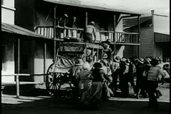 People gathering around horse drawn carriage Stock Footage