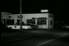 1950s police car arriving at police station - stock footage