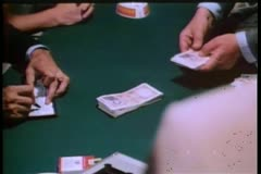 Man placing Italian lire on table Stock Footage