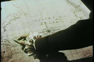 Hand pointing pencil to location on 19th century map Stock Footage