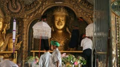 Visitors inside Taung Tho Pagoda Stock Footage