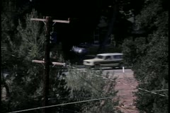 Car detouring from main road to side road Stock Footage