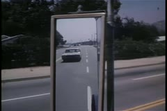 View from car side view mirror Stock Footage