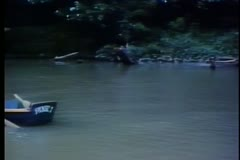 Empty row boat floating down river - stock footage