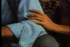 Close-up of woman's hand caressing man's arm - stock footage