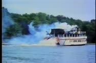 Steam boat traveling down river Stock Footage