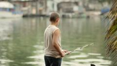 Young people and hobby, boy fishing on lake - stock footage
