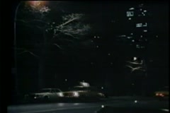 Traffic on Central Park West at night - stock footage