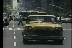 Taxi driving on New York City street Stock Footage