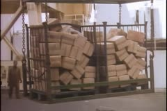 Cargo unloaded in Middle Eastern port Stock Footage