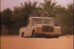 Soldiers shooting from military jeep Stock Footage