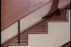 Close-up woman's legs walking down staircase - stock footage