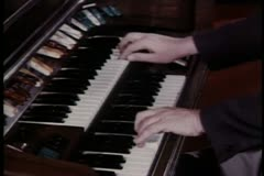 Close-up hands playing organ - stock footage