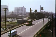 Cars and trucks crossing bridge Stock Footage