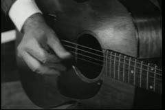 Close-up hand playing guitar - stock footage