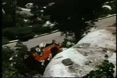 Car falling off cliff and blowing up - stock footage