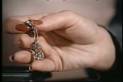 Close-up hand placing earring on table Stock Footage