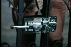 Hands opening gate lock Stock Footage