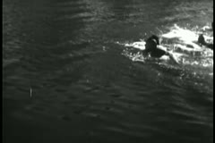 Native Americans swimming in lake Stock Footage