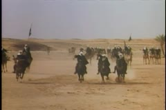 Armed Arabs charging through the desert Stock Footage