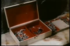 Hand putting earring in jewelry box Stock Footage