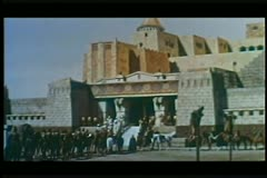Soldiers on horses lined up in front of palace Stock Footage