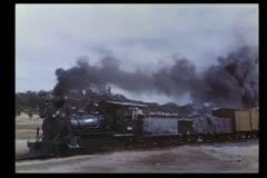 Locomotive racing through countryside - stock footage