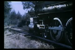 Locomotive wheels traveling down railroad track - stock footage