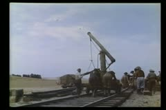 Men building railroad track Stock Footage