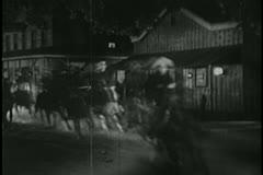 Men on horseback riding through town Stock Footage