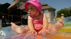 Cute Baby on Floaty in Pool Stock Footage
