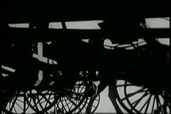 Wide shot of horse drawn carts on road - stock footage
