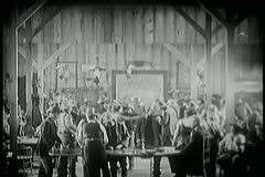 Wide shot of people dancing and gambling in saloon Stock Footage