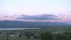 Clouds over lakeside town - time lapse by dwking Stock Footage