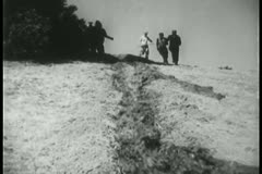 Workers shaping an irrigation canal - stock footage