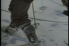 Men on expedition slipping on ice in Antarctica - stock footage