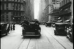 Police car chase through New York City streets, 1930s Stock Footage
