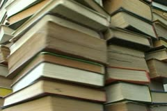 Stack of books turns - stock footage