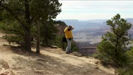 A tourist is photographing the Grand Canyon (Arizona, USA) Stock Footage