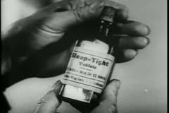 Close-up of hands opening bottle of sleeping pills Stock Footage